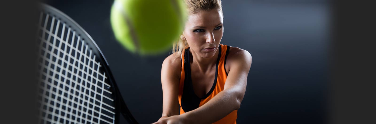 woman hitting tennis ball